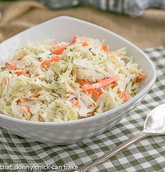 Classic Cole Slaw in a white serving bowl on a checked napkin