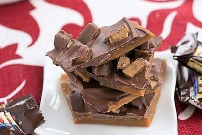 Double Dose English Toffee pieces on a small white plate