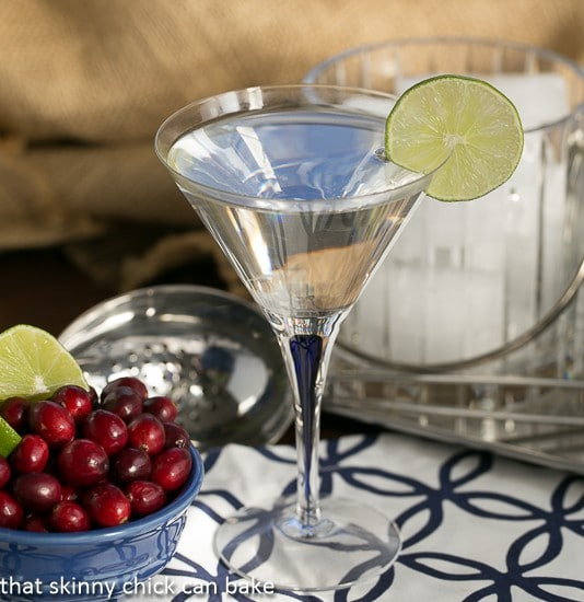 White Cosmopolitans garnished with a slice of lime