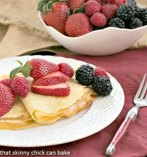 Butter and Rum Crêpes filled with lemon curd and topped with fresh berries