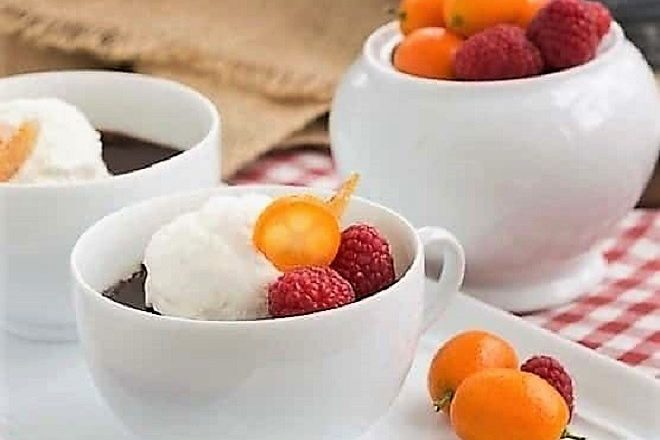 Chocolate Pots de Crème for Two on a white tray topped with whipped cream and fruit
