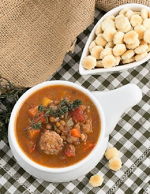 Sausage, Lentil and Vegetable Chowder in a soup bowl with crackers