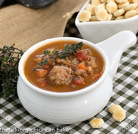 Sausage, Lentil and Vegetable Chowder in a white crock garnished with fresh thyme