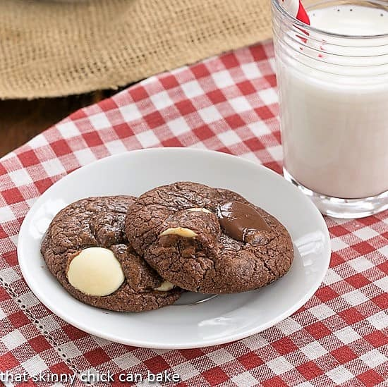 Brownie Drop Cookies on a white plate with a glass of milk