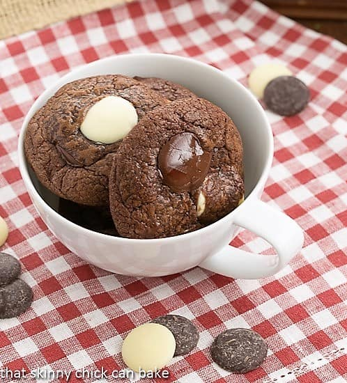 Brownie Drop Cookies in a tea cup sitting on a red and white checked napkin