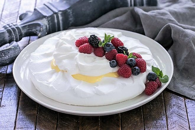Lemon on a cloud on a white serving plate