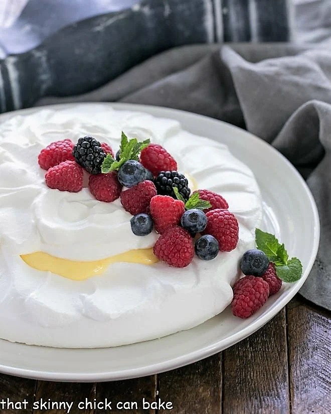 Lemon Pavlova on a white serving plate