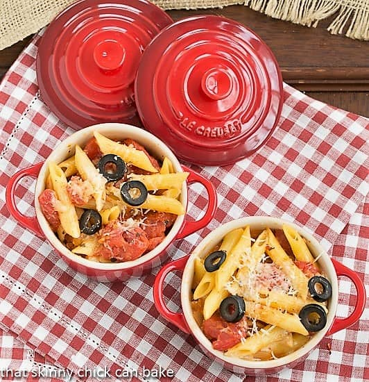 Overhead view of Spicy Penne with Tomatoes and Havarti in red crocks