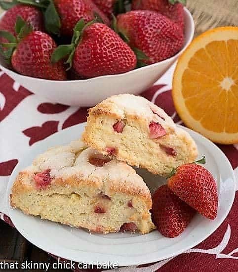 Strawberry Buttermilk Scones on a white plate with fresh strawberries