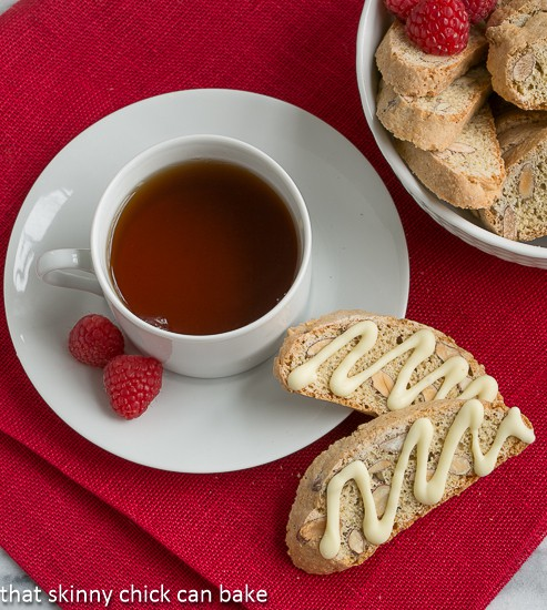 Overhead view of two Cantuciini or Almond Biscotti next to a cup of tea