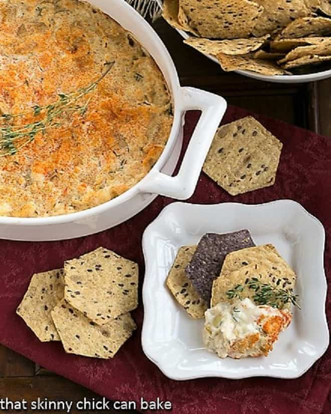 Overhead view of Hot Artichoke Shrimp Dip in a casserole and on a small plate