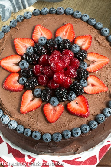 Layered Chocolate Mousse Cake from above with a decorative berry topping