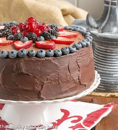 Layered Chocolate Mousse Cake on a cake stand