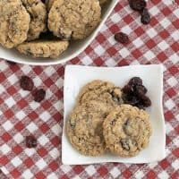 Oatmeal Craisin Cookies viewed from above on a white plate featured image