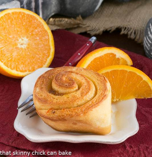 A Orange Marmalade Sweet Roll on a square white plate