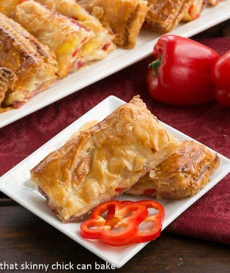 Puff Pastry Antipasto Squares on a small white plate with mini pepper rings