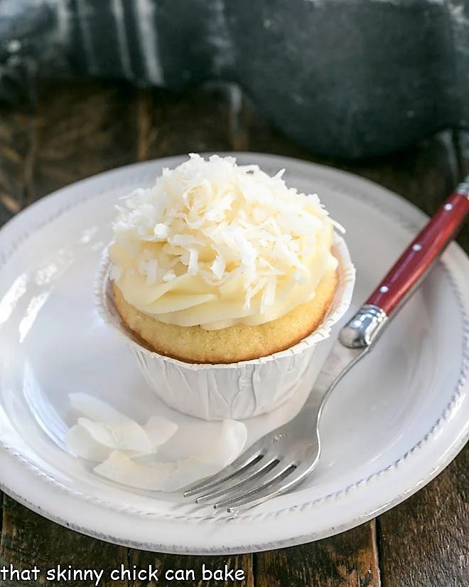 Coconut Cupcakes with Cream Cheese Frosting on a small white plate