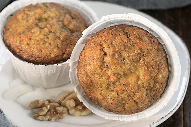 2 Cream Cheese Filled Carrot Cake Muffin on a round white plate
