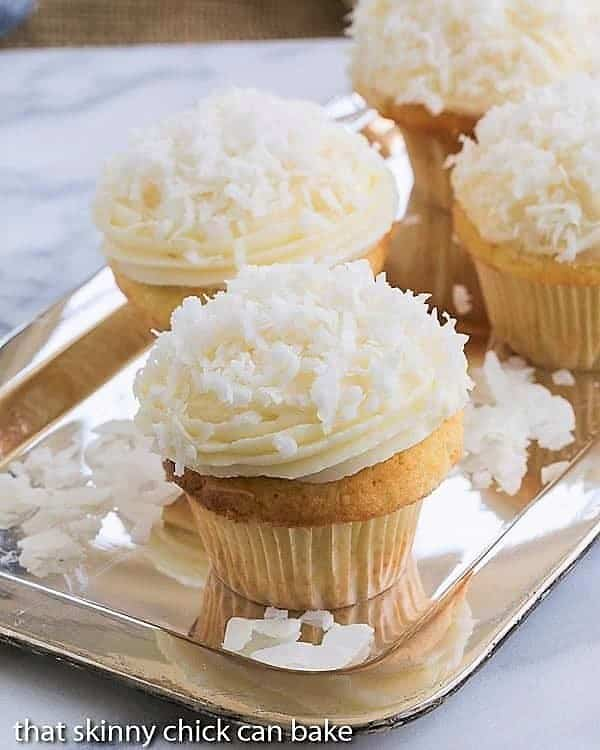 Coconut Cupcakes with Cream Cheese Frosting on a silver tray