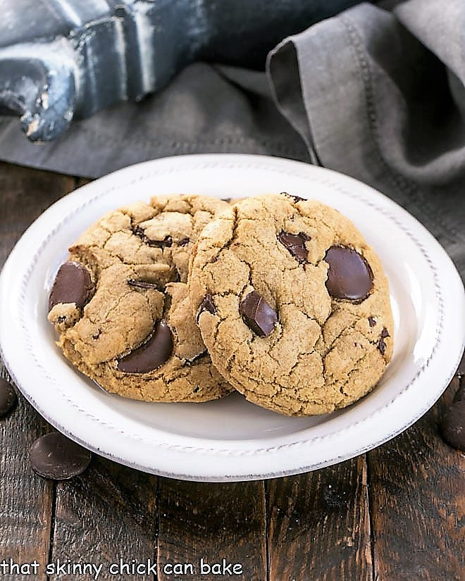 Jumbo Chocolate Chip Cookies on a round white dessert plate