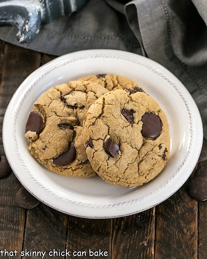 Overhead view of jumbo chocolate chip cookies on a white plate