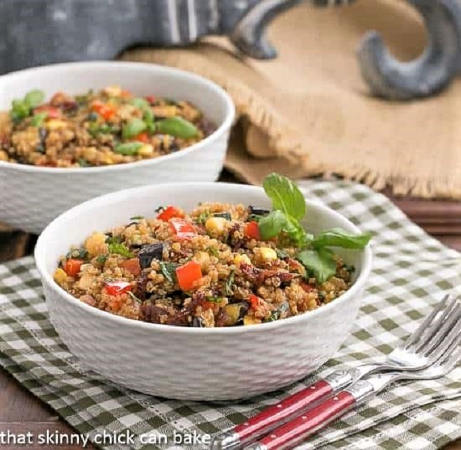 Two bowls of quinoa salad on a checked napkin