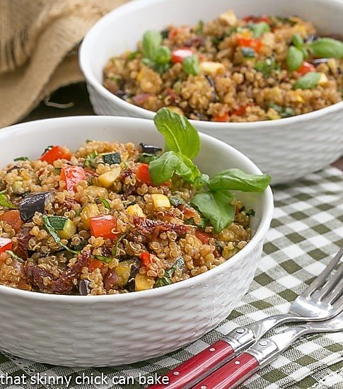 Quinoa Salad with Roasted Vegetables in two white bowls