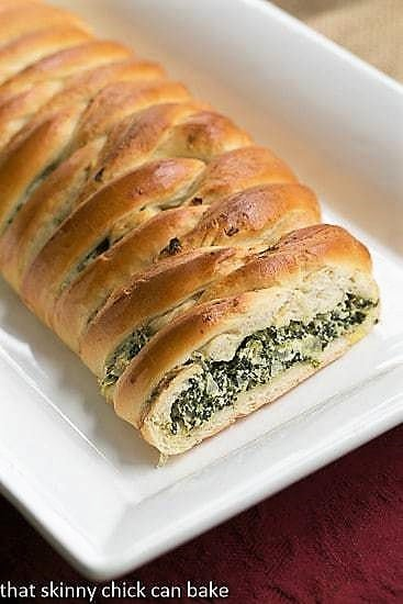 Spinach and Onion Braid on a long white platter with the filling exposed