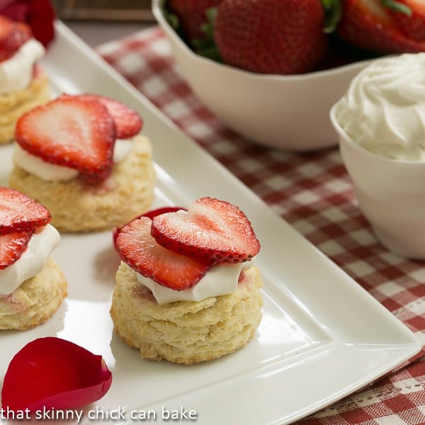 Double Strawberry Rose Shortcakes  on a white ceramic tray garnished with rose petals