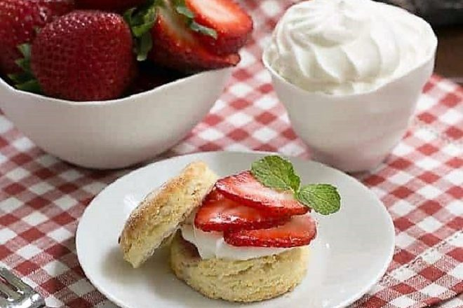 Double strawberry rose shortcake on a white dessert plate