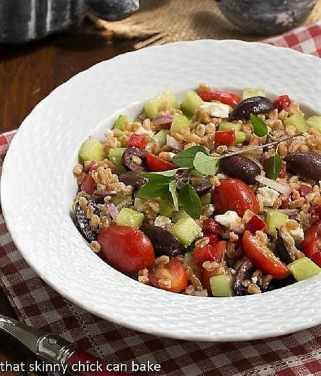 Greek Farro Salad from in a white basketweave bowl