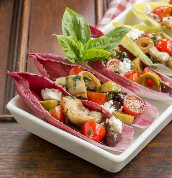 Close view of Mediterranean Endive Boats in a  white, rimmed serving tray