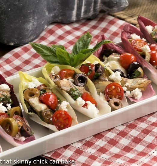 A plate of food on a table, with Endive and Salad