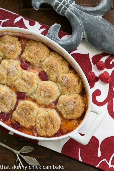 Overhead view of a Fruit Cobbler in a white, oval casserole dish
