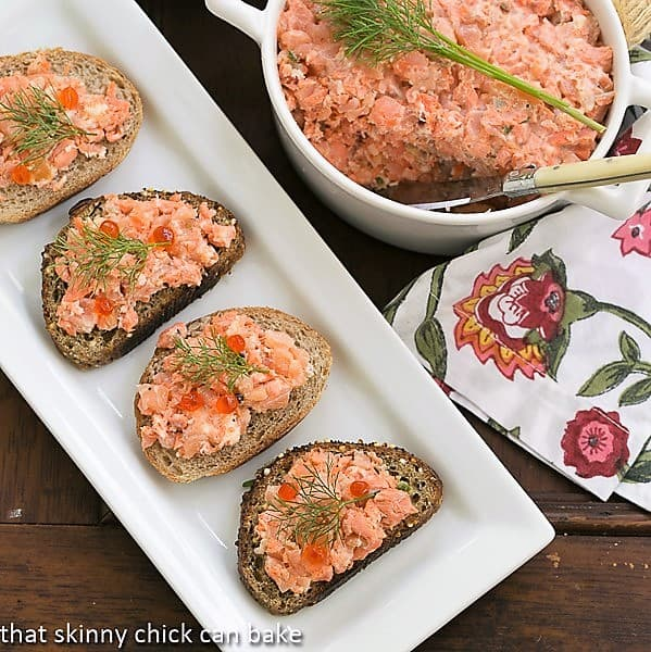 Salmon Rillettes on a white tray with a terrine of the salmon spread