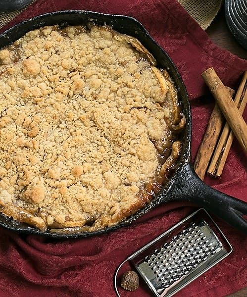 Grilled Apple Crisp in a cast iron pan