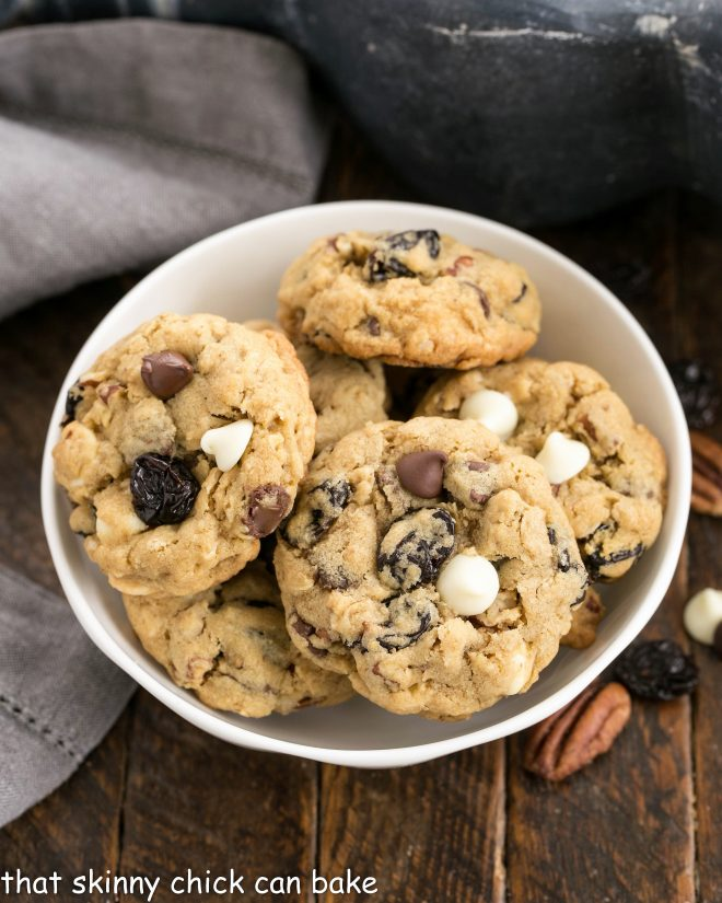Overhead view of Oatmeal, Cherry and Chocolate Chip Cookies in a white ceramic bowl