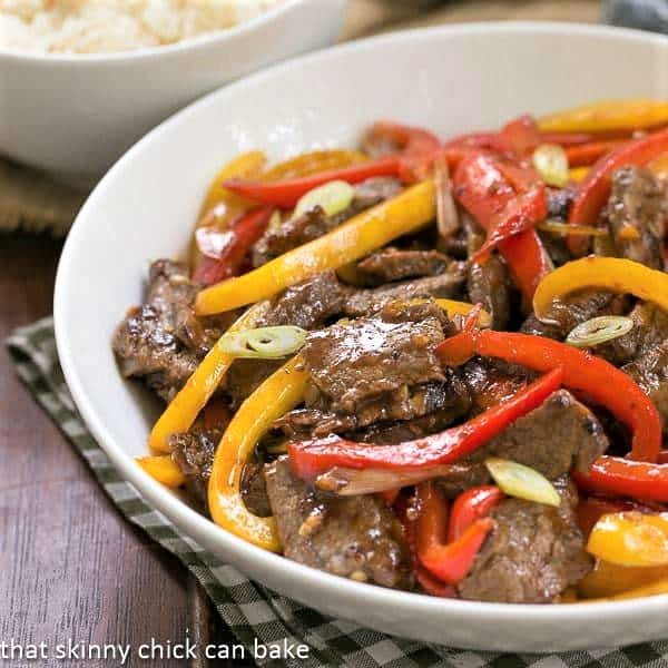 Asian Beef with Peppers in a white serving bowl