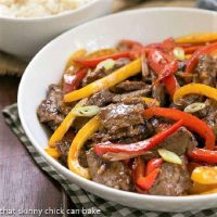Asian Beef with Peppers in a white serving bowl featured image