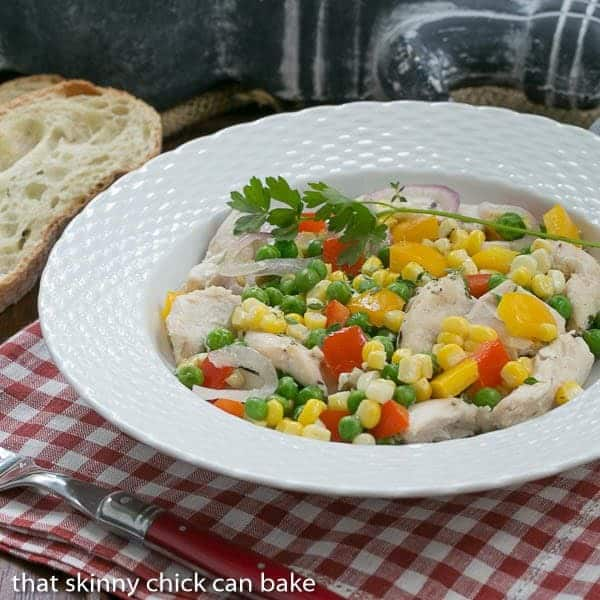 Chicken Peppers and Peas en Papillote - Chicken and vegetables cooked in foil packets