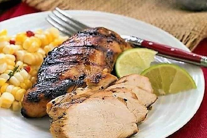 Mustard, Garlic, Lime Marinated Chicken Breasts on plate with fork