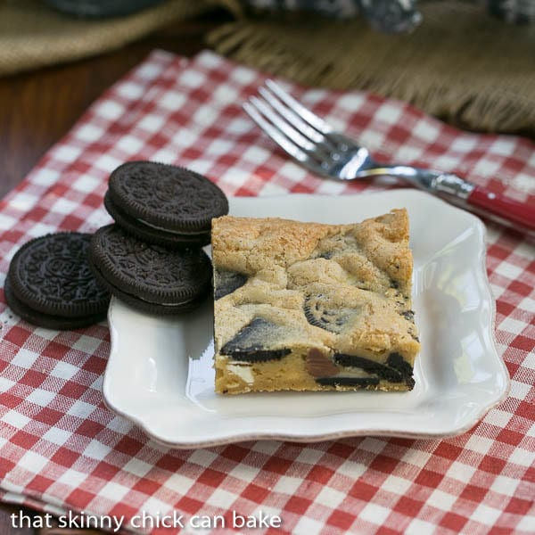 Oreo Chocolate Chip Bars on a white plate with Oreos to garnish