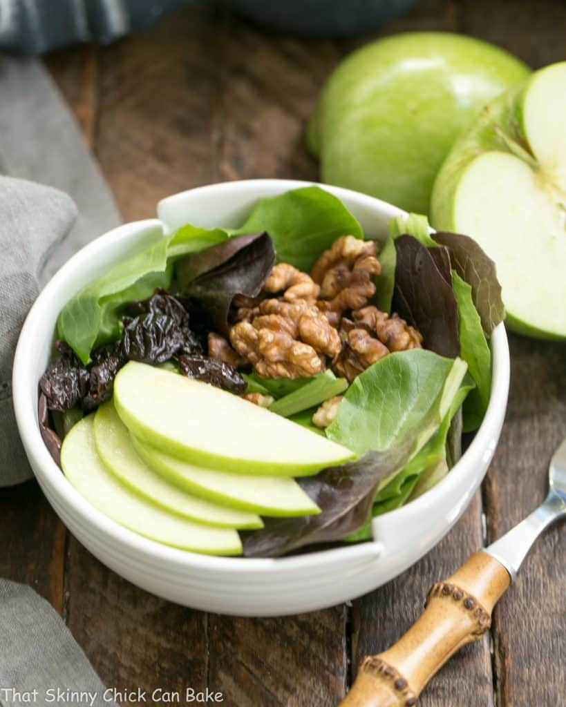 Apple, Cherry, Walnut Salad with Maple Dressing in a white salad bowl