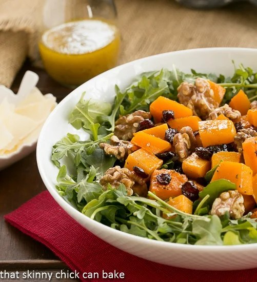 Arugula Salad with Roasted Butternut Squash in a white salad bowl