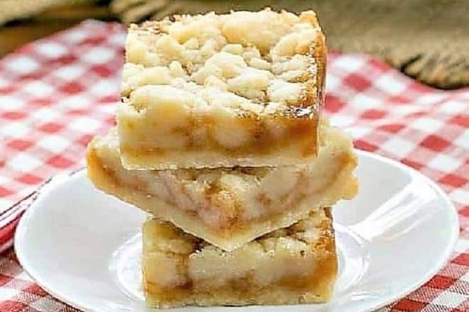 Caramel Butter Bars stacked on a round white plate