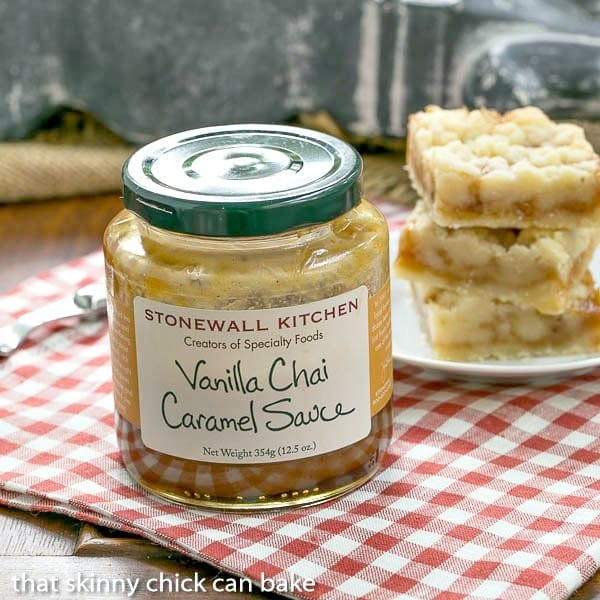 Caramel Butter Bars in the background with a jar of caramel sauce