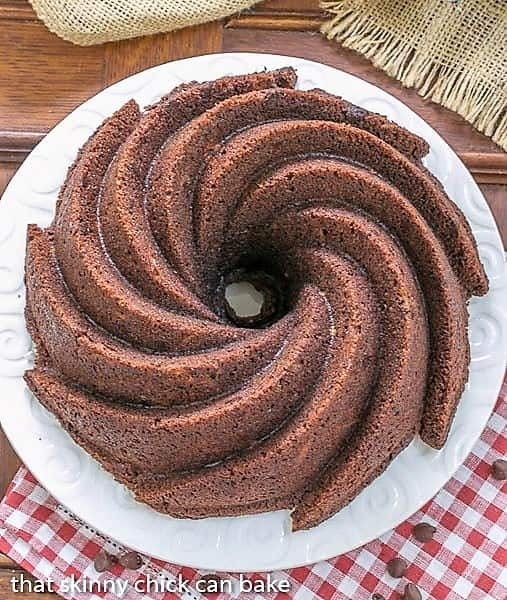 Overhead view of Chocolate Zucchini Bundt Cake on a white cake plate