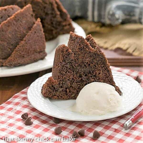 Chocolate Zucchini Bundt Cake slice with ice cream on a checked napkin