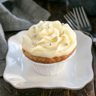 Vanilla cupcake on a square white plate