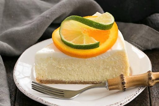 A slice of margarita cheesecake on a white plate